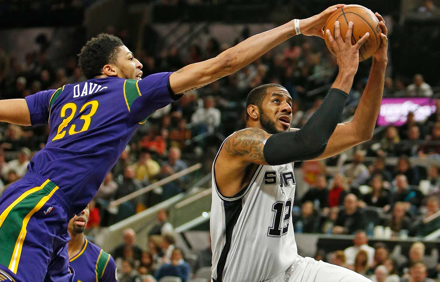 LaMarcus Aldridge of the San Antonio Spurs drives past Anthony Davis of the New Orleans Pelicans at AT&T Center in San Antonio.