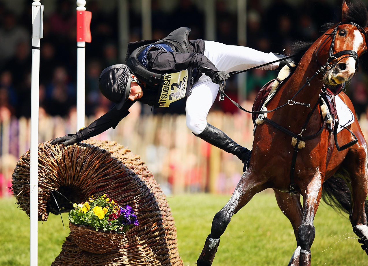 Niklas Bschorer, of Germany, falls off of TomTom Go 3 during the Cross Country Test competition at the Badminton Horse Trials in Gloucestershire, England.