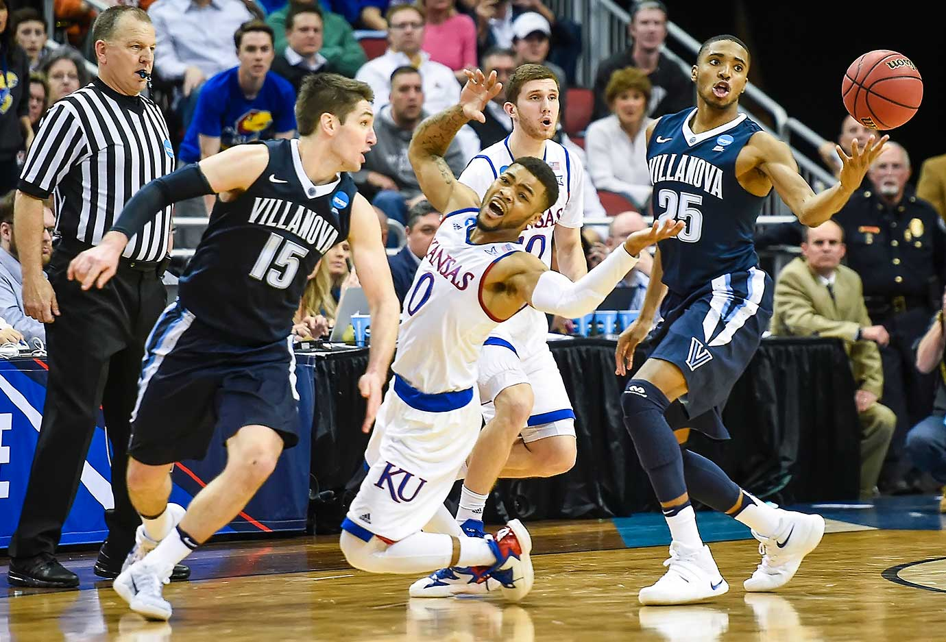 With Kansas down three points with 25 seconds left, Wildcats guard Frank Mason III had the ball slapped away by Ryan Arcidiacono (15) — game over.