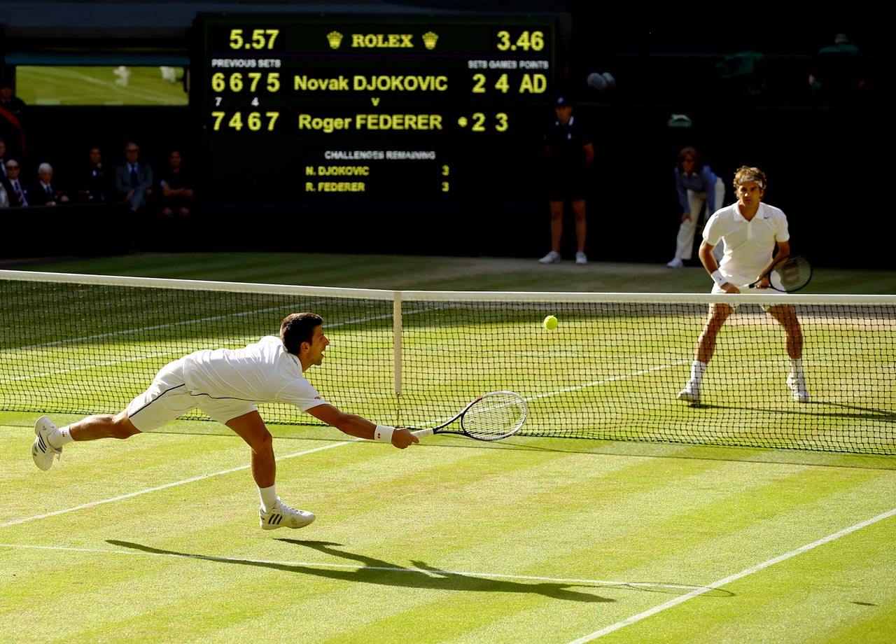 Novak Djokovic beats Roger Federer at Wimbledon in a five-set match, moving him back to the world No. 1 ranking after he captured his seventh Grand Slam title.