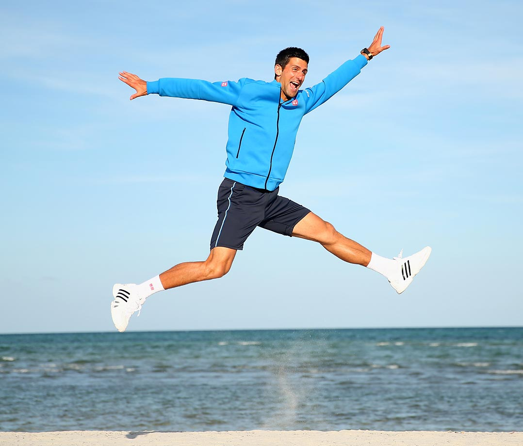 Novak Djokovic leaps into the air on Crandon Park beach after his three-set victory against Andy Murray in the Miami Open.