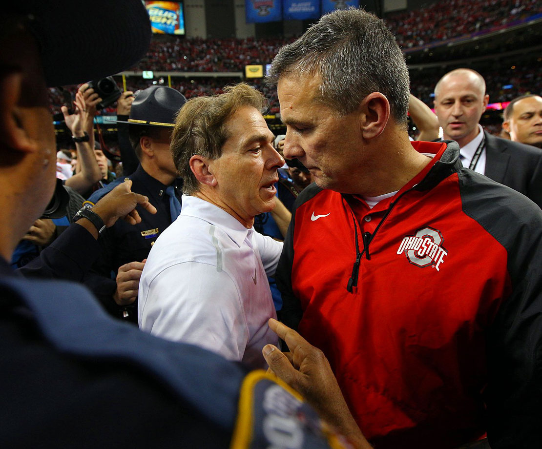 Denied a shot at his fourth national title in six years, Alabama coach Nick Saban congratulates Urban Meyer on his team's victory.