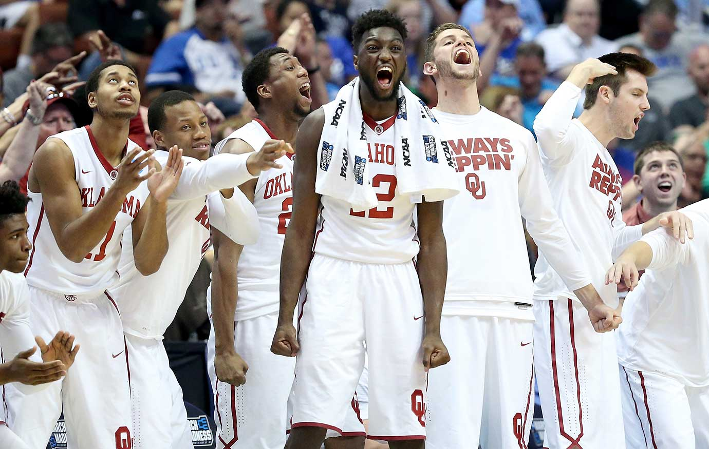 Khadeem Lattin (12) and the Oklahoma bench cheer on their teammates during the win over Texas A&M.