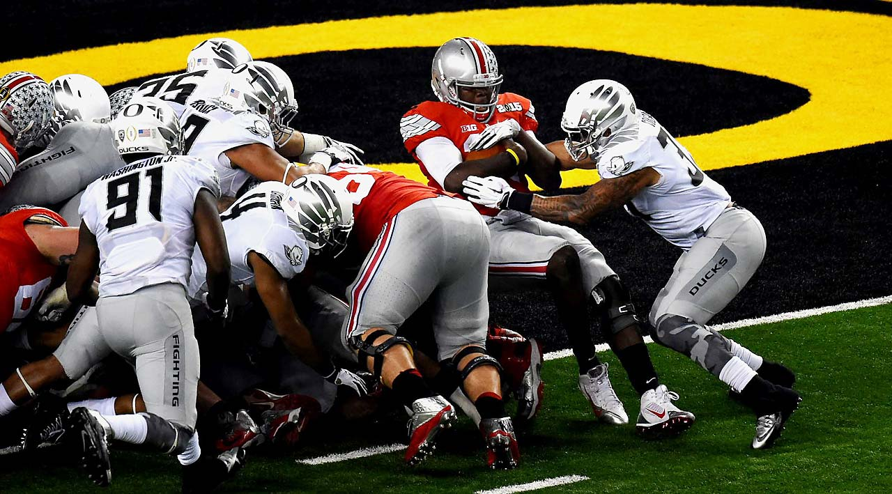Ohio State quarterback Cardale Jones spun out of a tackle and bulled his way in for a touchdown on this play.