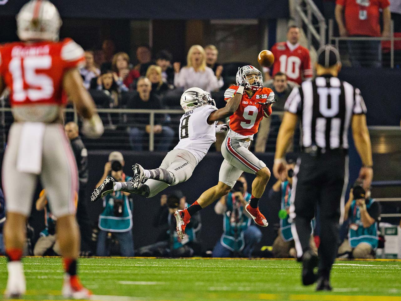 Ohio State wide receiver Devin Smith attempts a catch over Oregon cornerback Reggie Daniels.