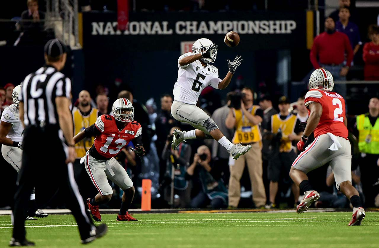 Oregon wide receiver Charles Nelson rises for a catch between two Ohio State defenders.