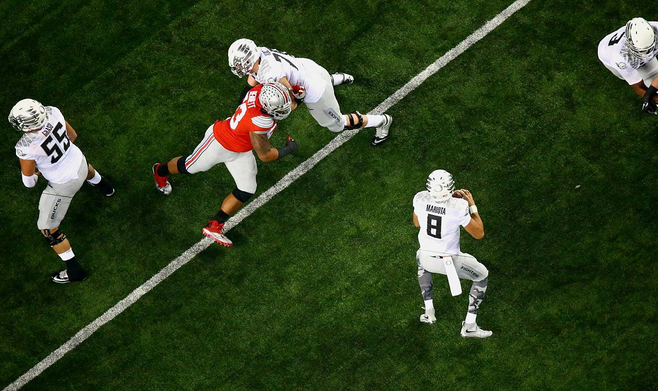 Oregon quarterback Marcus Mariota drops back to pass. Mariota combined for 372 yards in the air and on the ground.
