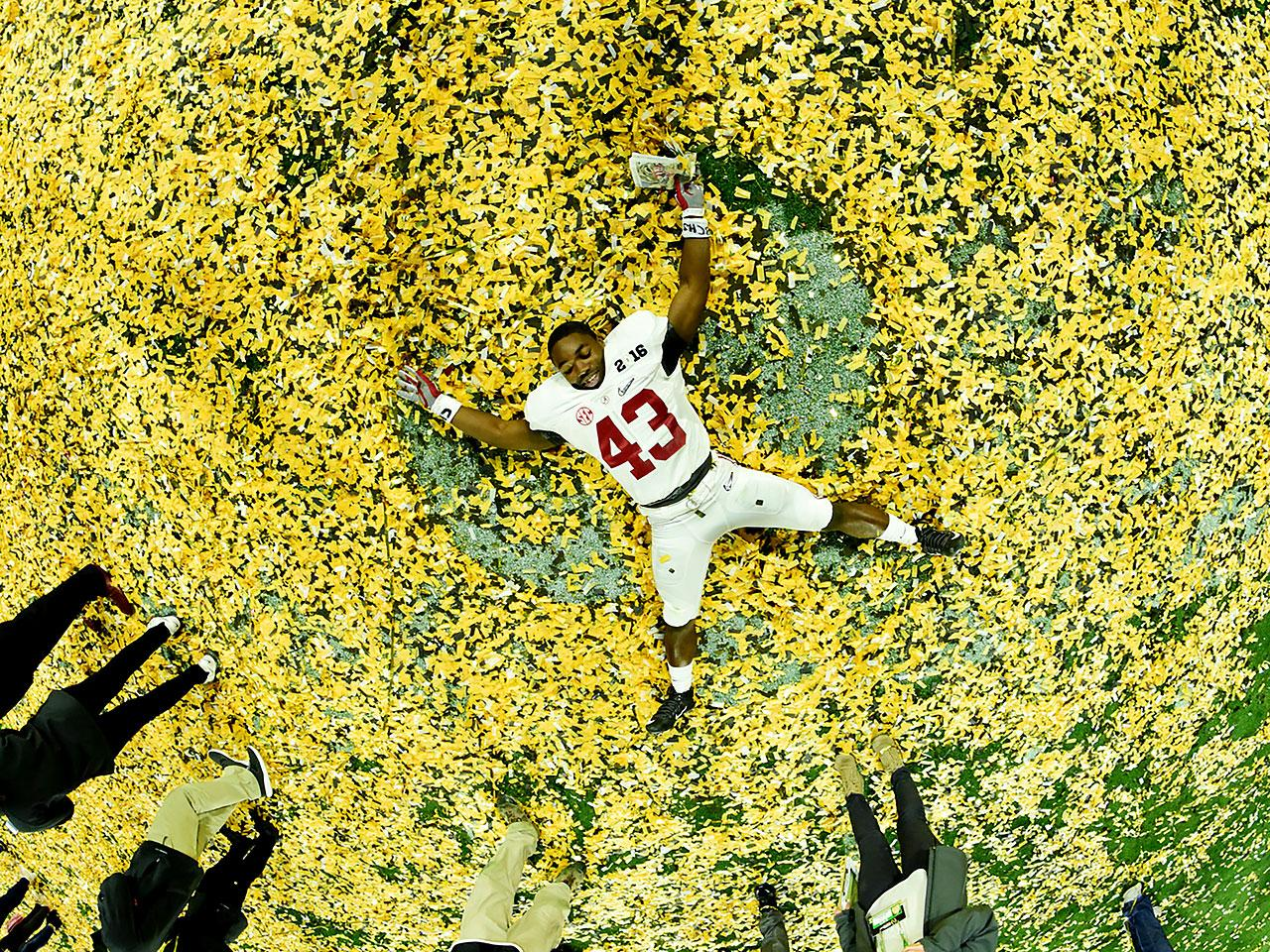 Crimson Tide running back Lawrence Erekosima works on a confetti angel after Alabama's win over Clemson in the 2016 national title game.