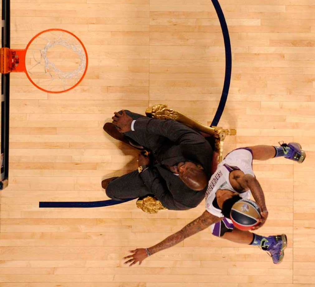 Ben McLemore dunks over Shaquille O'Neal during the 2014 NBA All-Star Weekend in New Orleans.