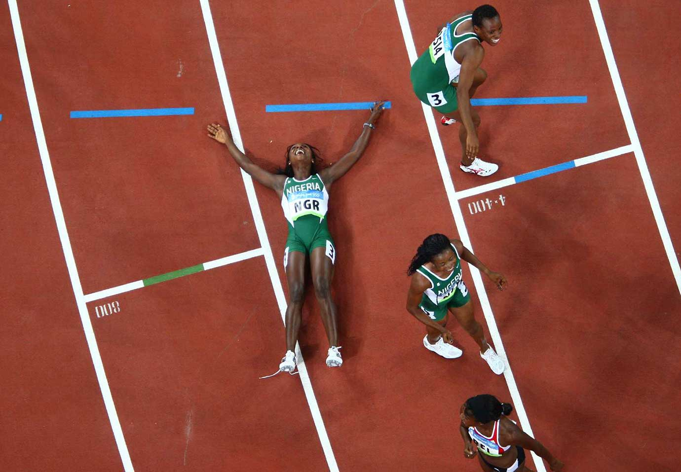 Nigeria's 4x100 meter relay team rejoices after winning the bronze medal at the 2008 Olympic Games in Beijing.