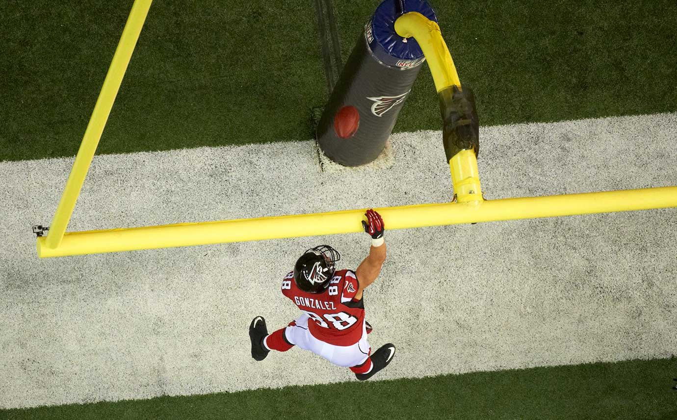 Tony Gonzalez does his signature dunk over the goal post, this time after scoring in a 2013 playoff game against San Francisco.
