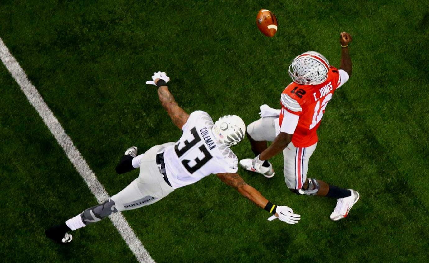 Oregon linebacker Tyson Coleman takes aim at Ohio State quarterback Cardale Jones in the 2015 college football national title game.