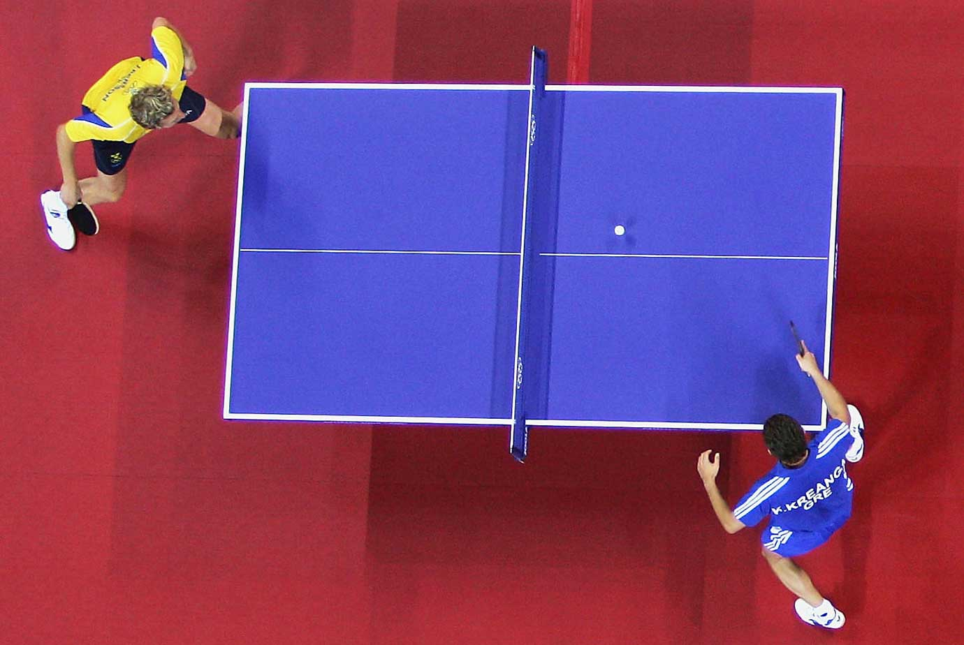 Jorgen Persson of Sweden and Kalinikos Kreanga of Greece compete in table tennis at the Athens 2004 Summer Olympic Games.