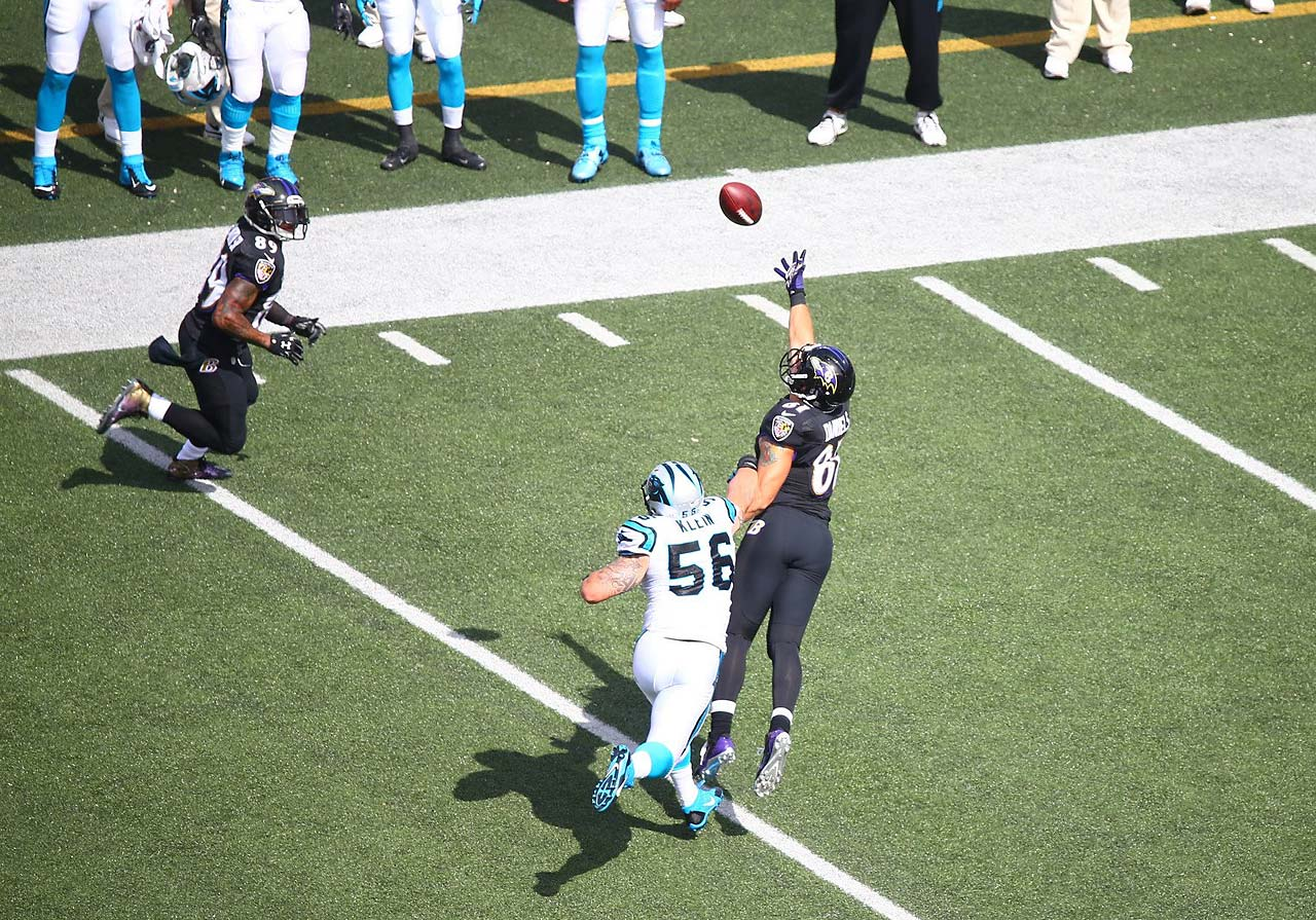 Owen Daniels couldn't pull down this pass, but ended up deflecting it, which allowed Steve Smith (left) to catch it and score a touchdown.
