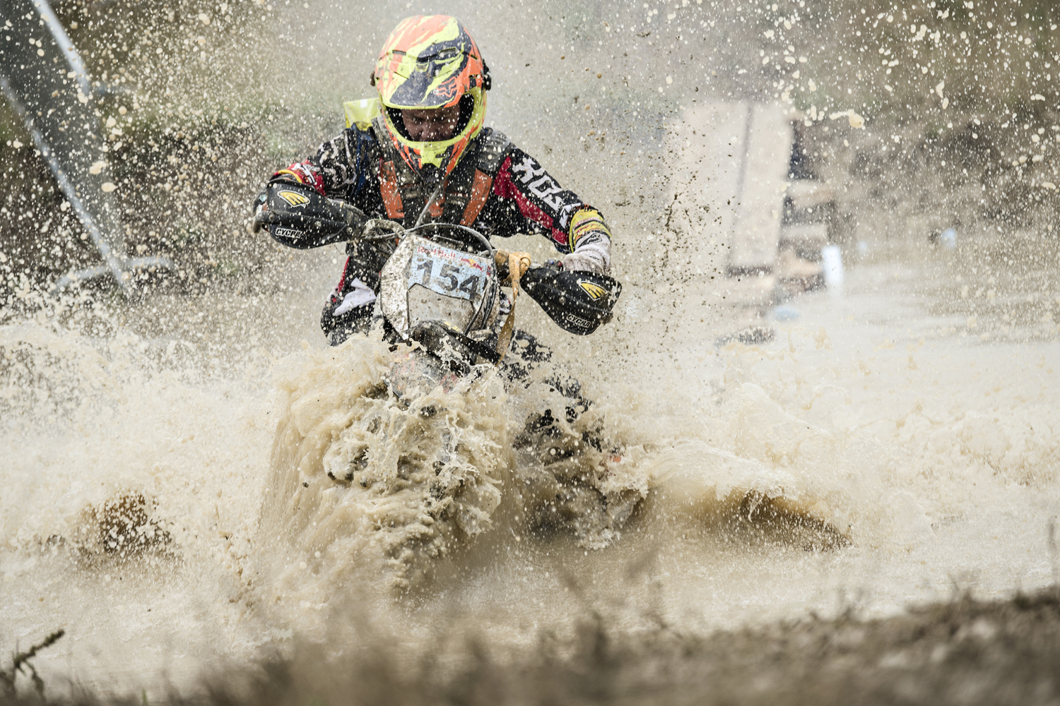 A competitor races through the mud during the Red Bull Romaniacs in Sibiu, Romania.