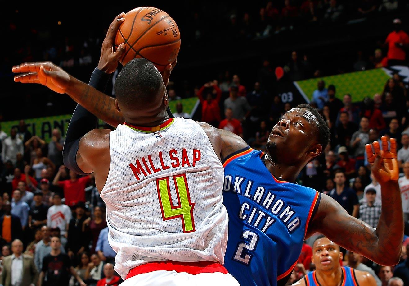Anthony Morrow of the Oklahoma City Thunder fouls Paul Millsap of the Atlanta Hawks.