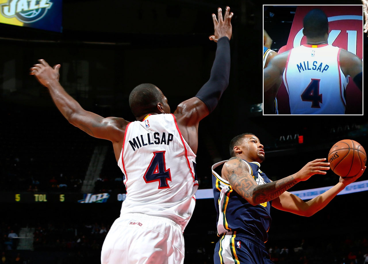 Millsap may have been missing an 'L' in the first half (inset), but the Hawks' power forward had a season-high 30 points and 17 rebounds to help the Atlanta beat the Utah Jazz 100-97 on Nov. 12, 2014.  This was the second misspelled NBA jersey in three days.