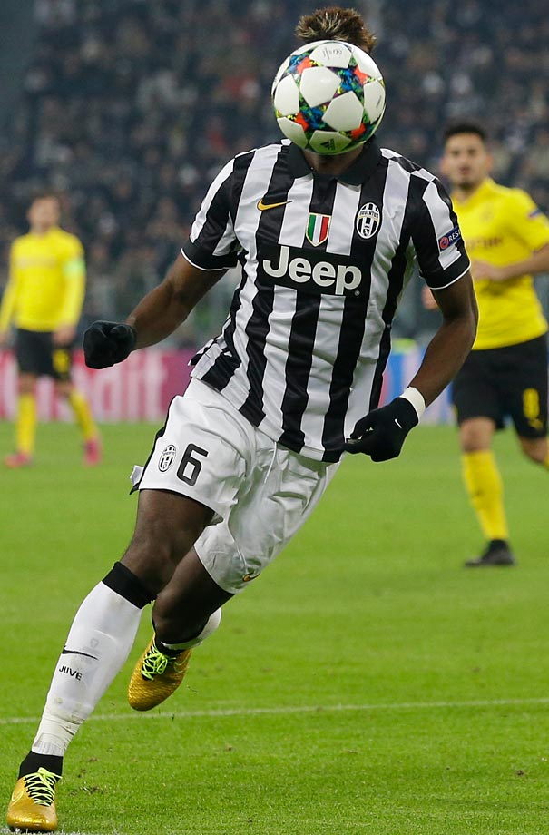 Juventus' Paul Pogba runs towards the ball during the Champions League round of 16 first leg soccer match between Juventus and Borussia Dortmund.