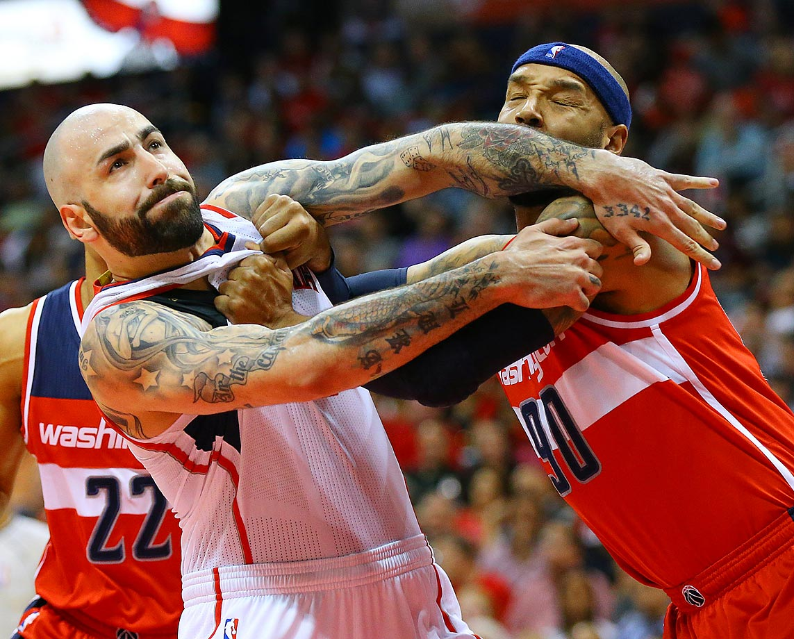 Hawks' Pero Antic and Wizards' Drew Gooden.