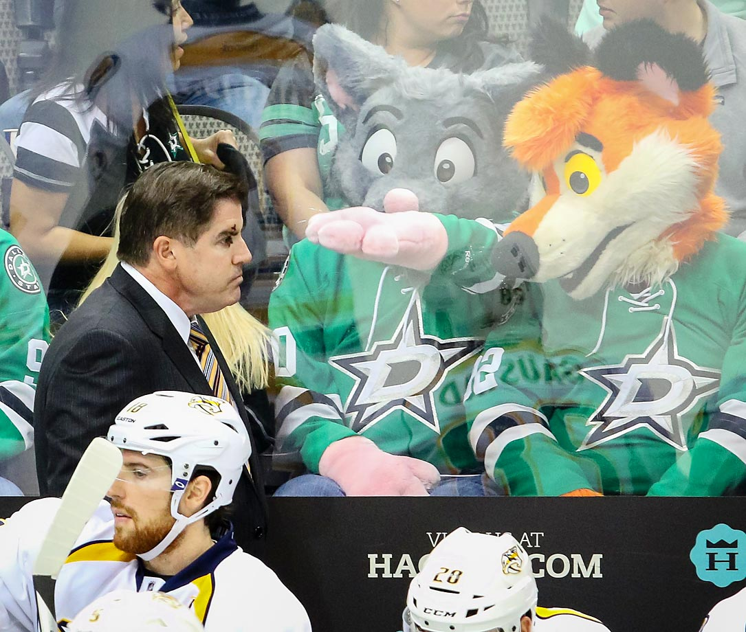 Nashville Predators coach Peter Laviolette is heckled by fans during a game against the Dallas Stars.