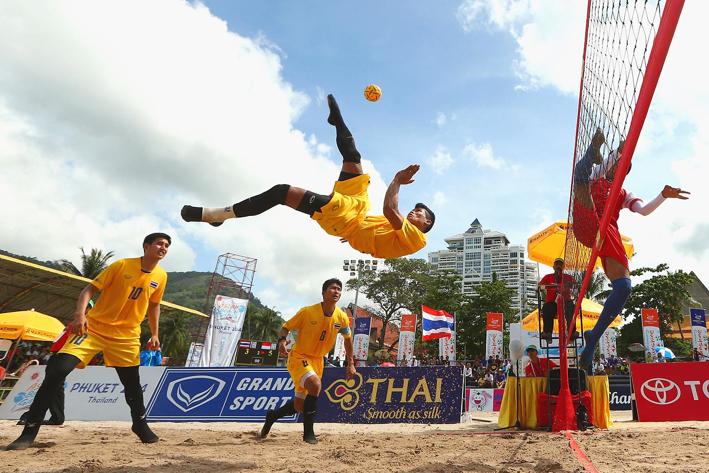 Phakpong Dejaroen of Thailand plays a shot during the Beach Sepaktakraw Regu finals at the Asian Beach Games.