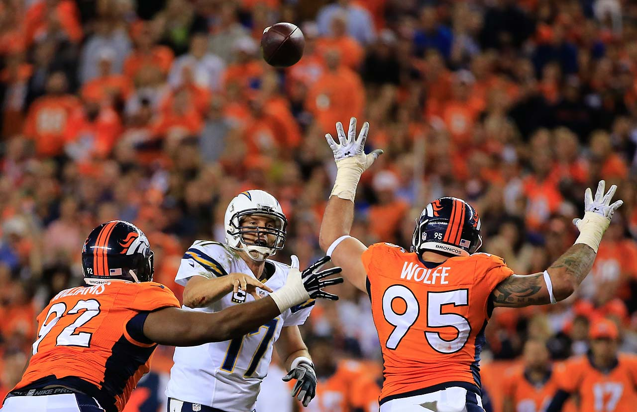 Philip Rivers throws as he is pressured by defensive tackle Sylvester Williams  and defensive end Derek Wolfe of the Denver Broncos.