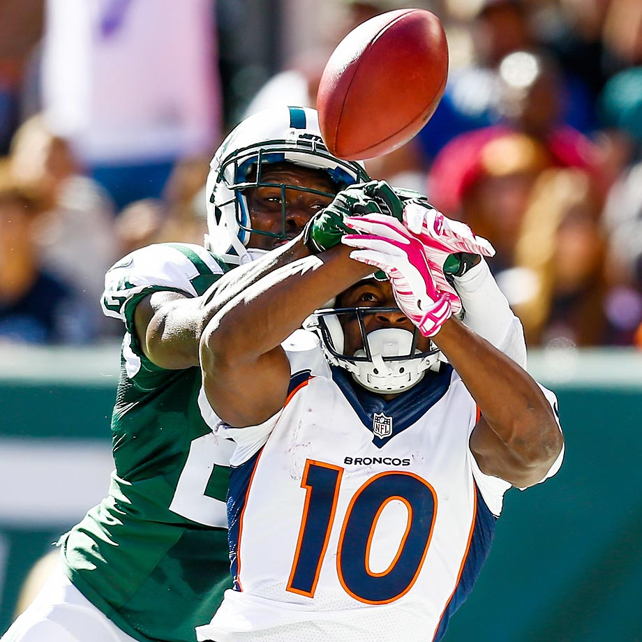 Phillip Adams of the New York Jets breaks up a pass intended for Emmanuel Sanders of the Denver Broncos.