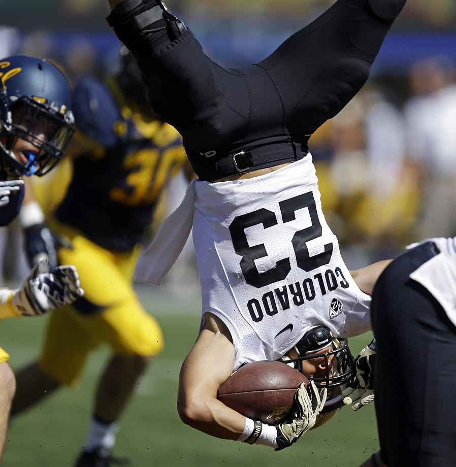 Colorado's Phillip Lindsay is upended on a punt return against California.