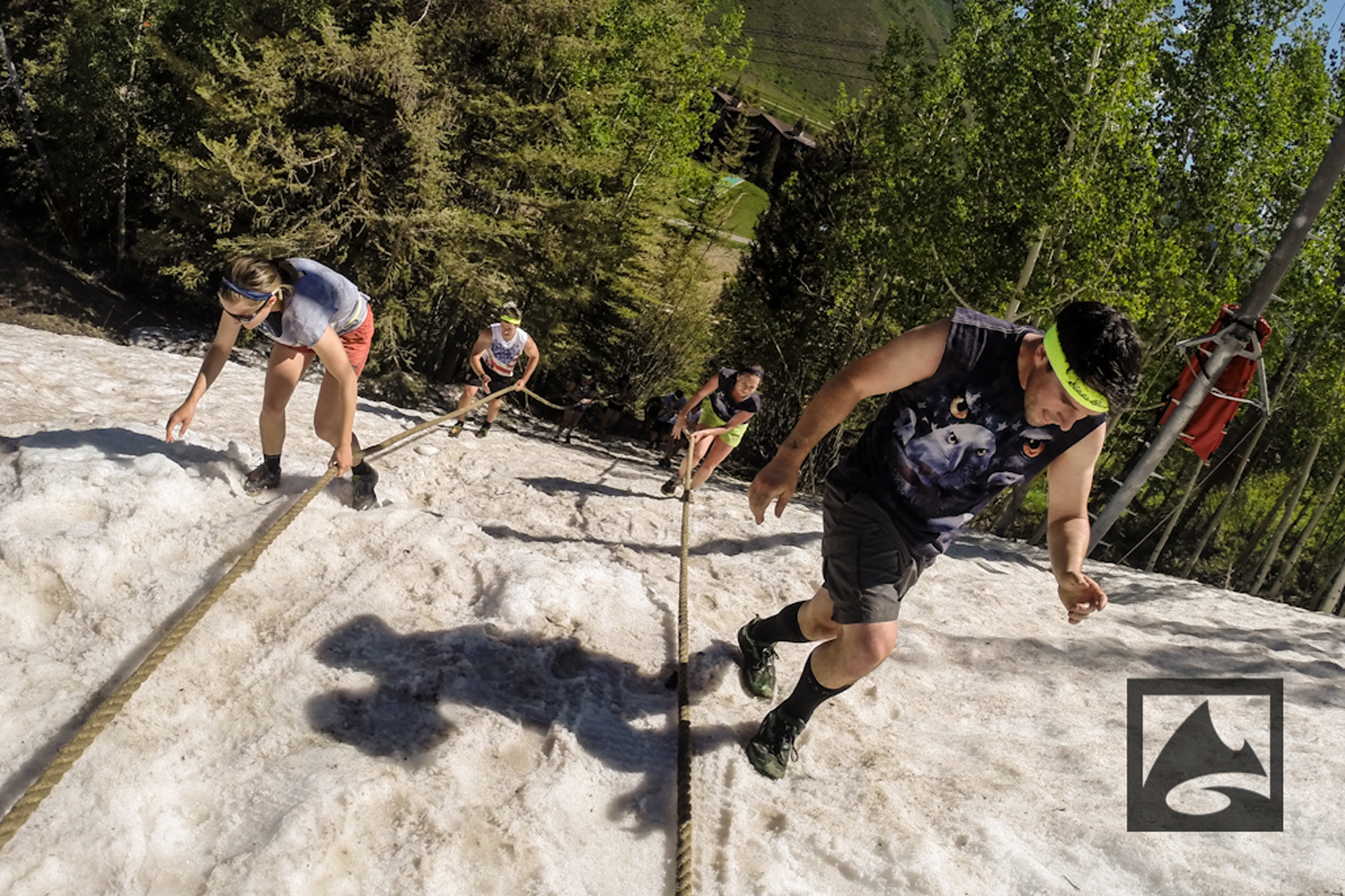 Competitors in The Eddie Bauer BADASS Dash, a 7K course with more than 25 unconventional obstacles to complete, trekked up a snow-covered mountain during part of the race.