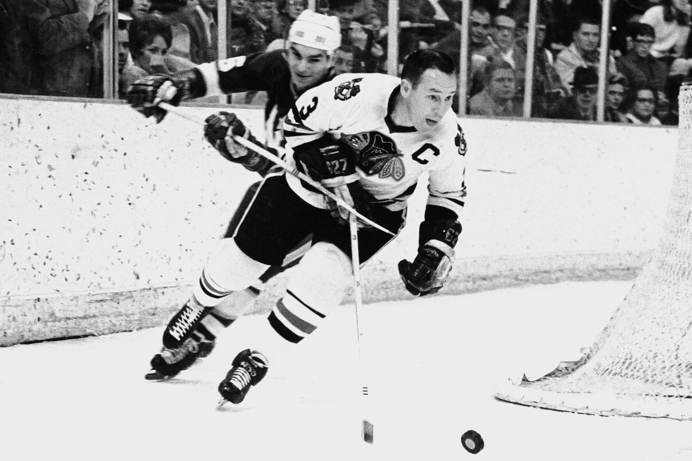 "Although he began playing hockey rather late — at age 17 — the Quebec native quickly left his mark in the Blackhawks organization. A true tough guy on the backline, Pilote sacrificed his body to block shots and deliver bone-jarring checks. He once knocked out both Henri and Maurice Richard of the Canadiens during the same play. Paired with Elmer ""Moose"" Vasko, the two were pillars of Chicago's 1961 Stanley Cup championship team, which Pilote captained. He was awarded the Norris Trophy three years in a row (1963-65) and was inducted into the Hockey Hall of Fame in 1975."