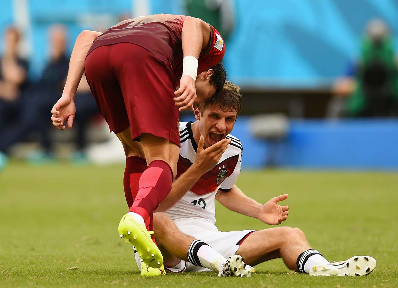 Pepe of Portugal headbutts Thomas Mueller of Germany, resulting in a red card during Portugal's 4-0 loss in a Group G match at Arena Fonte Nova on June 16.
