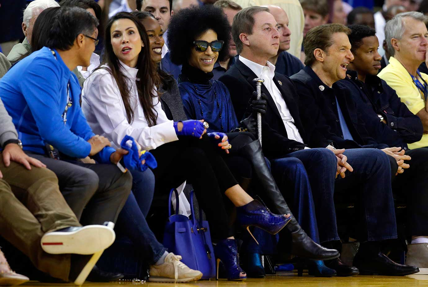 Singer Prince smiles as he watches the Golden State Warriors game vs. Oklahoma City in Oakland.