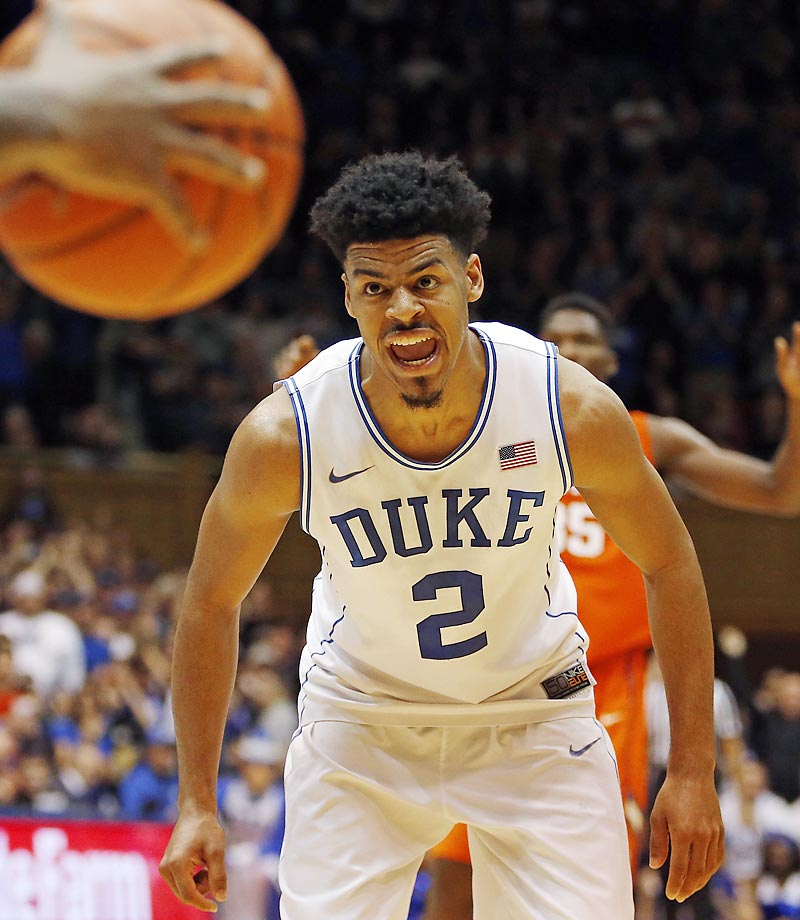 Duke's Quinn Cook fires up the crowd as a Clemson player brings the ball downcourt.