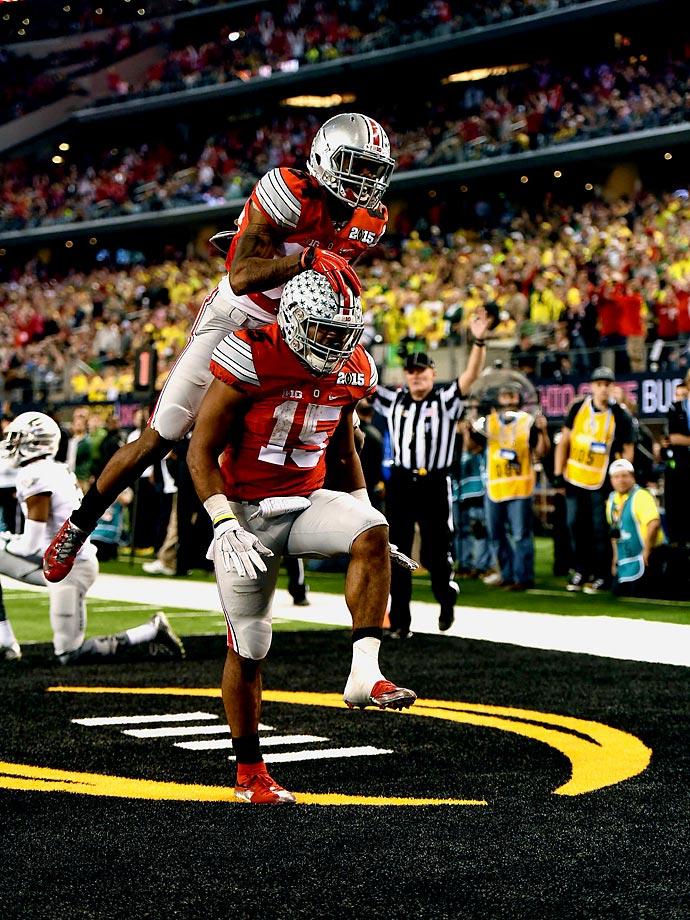 Ezekiel Elliott celebrates with teammate Corey Smith after one of his four touchdowns.