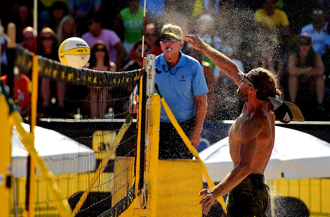 Ty Tramblie loses his hat and shakes off a bit of sand with a hammer shot on Saturday.