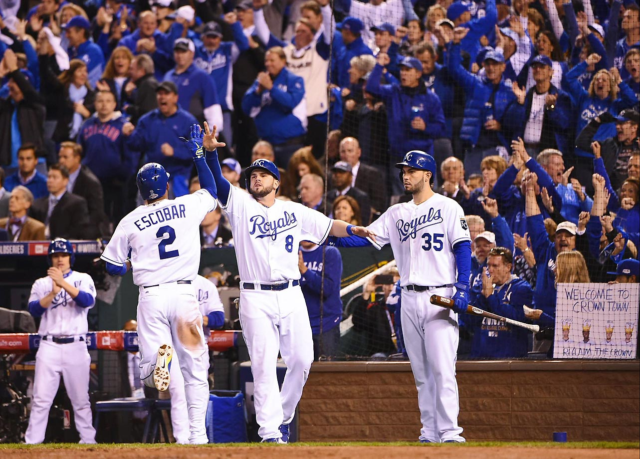 Royals shortstop Alcides Escobar celebrates with Mike Moustakas and Eric Hosmer.