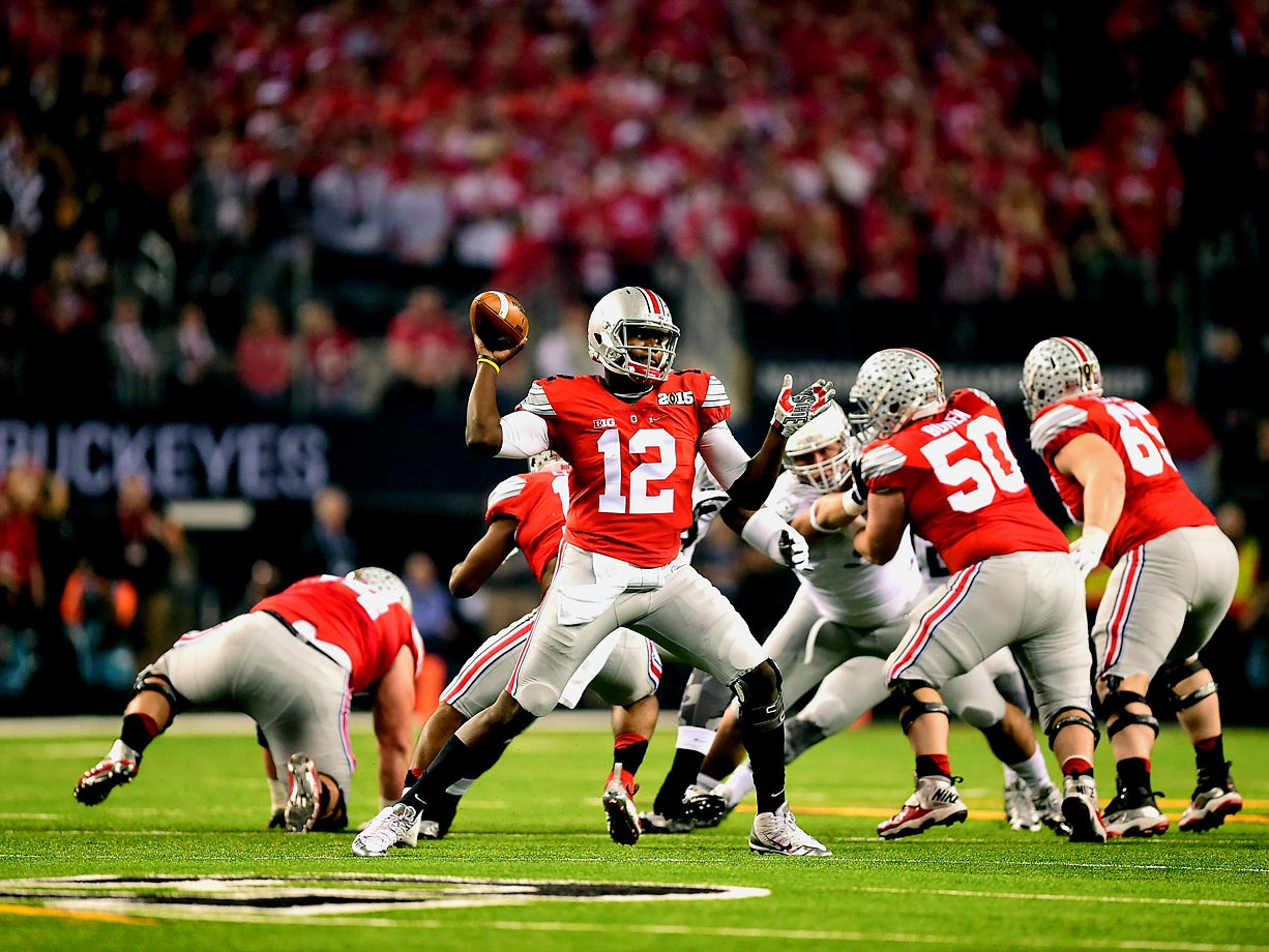 Ohio State quarterback Cardale Jones drops back to throw. Jones finished with 242 yards against the Oregon Ducks in the Buckeyes' 42-20 win.
