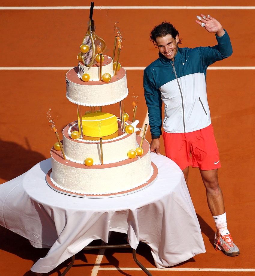 Rafael Nadal celebrated his 27th birthday with this mammoth cake presented to him at the 2013 French Open.