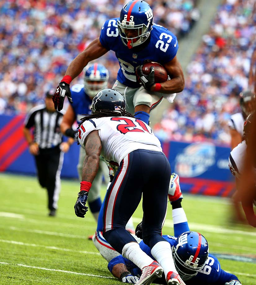 Rashad Jennings tries to go over the top during his career-high 176-yard rushing day.