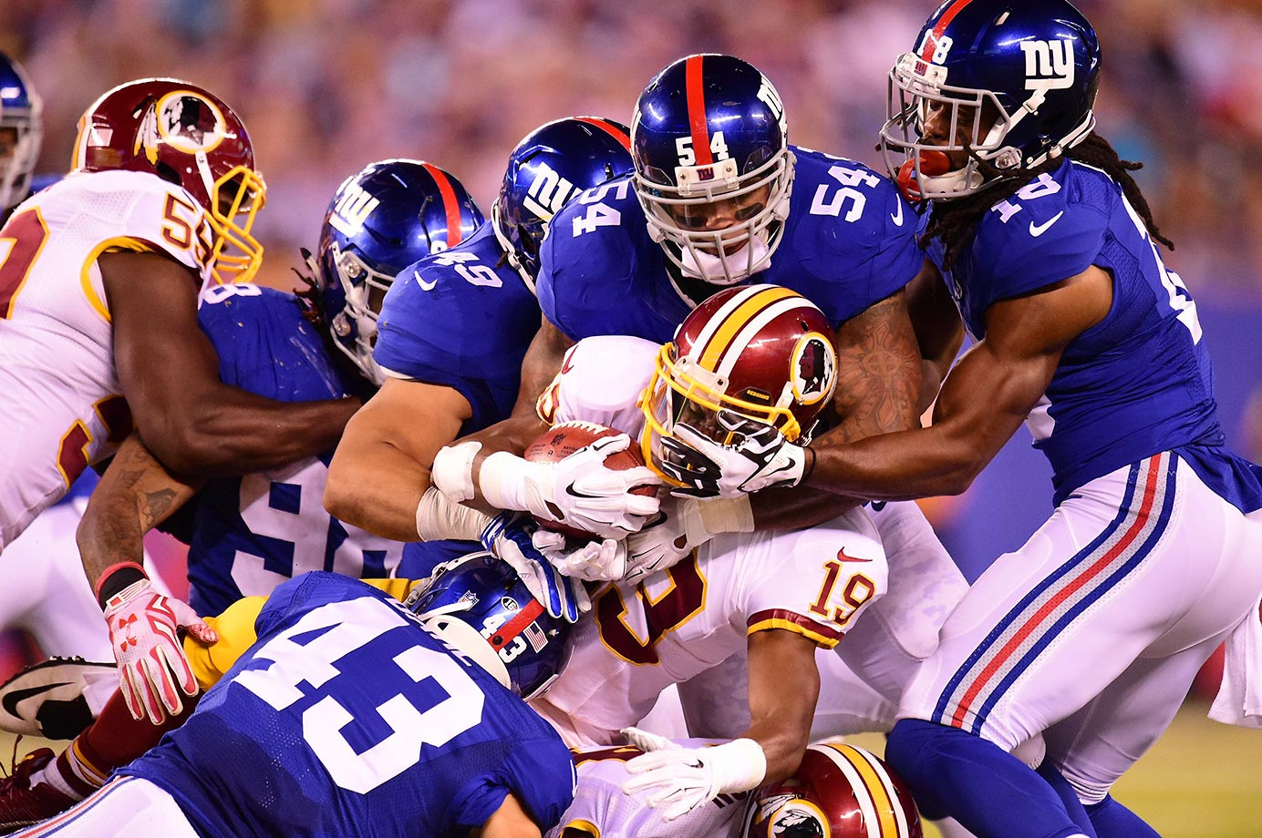 Rashad Ross is swarmed by the New York Giants defense.