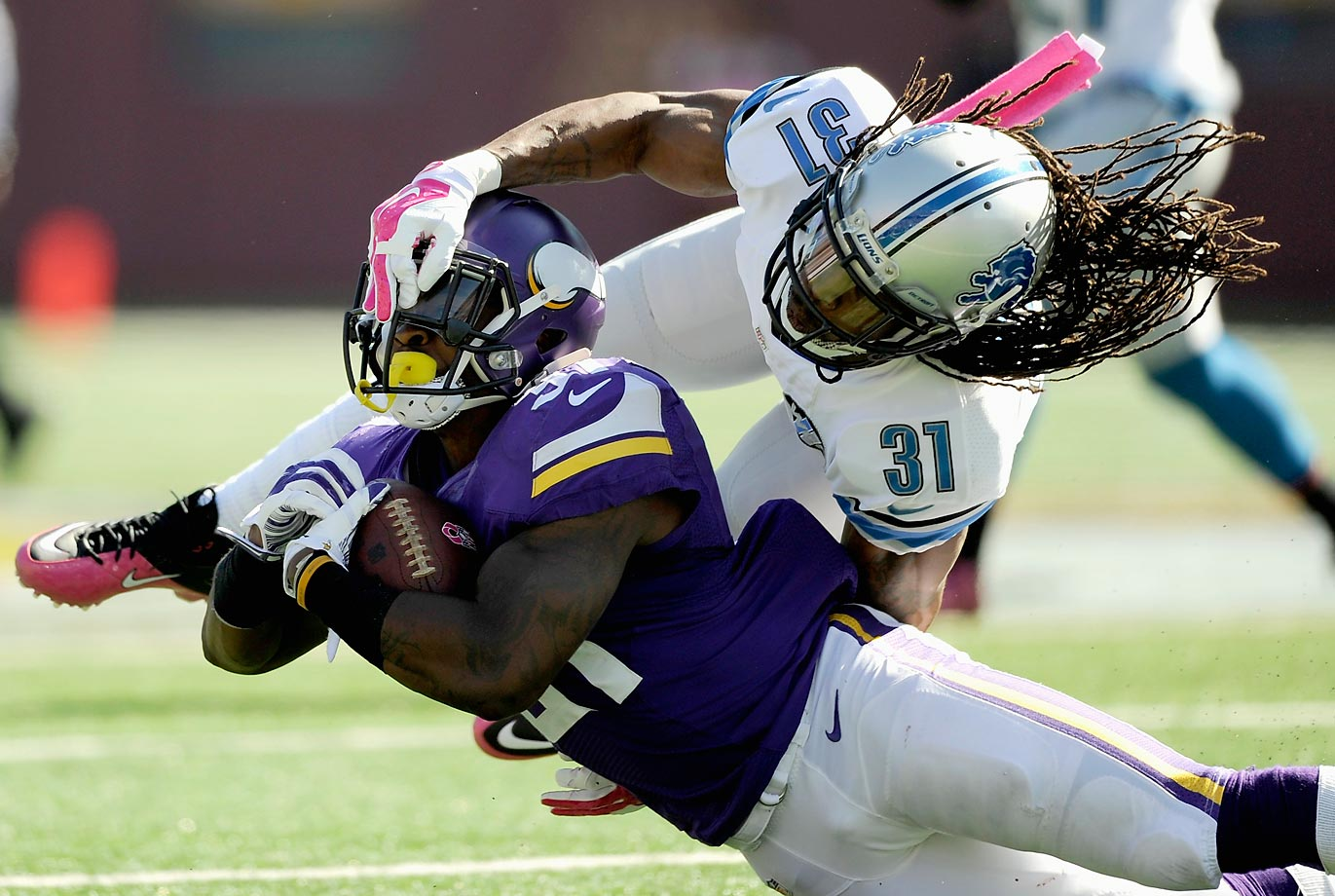 Detroit Lions cornerback Rashean Mathis tackles Minnesota Vikings running back Jerick McKinnon. The Lions won the division matchup 17-3.