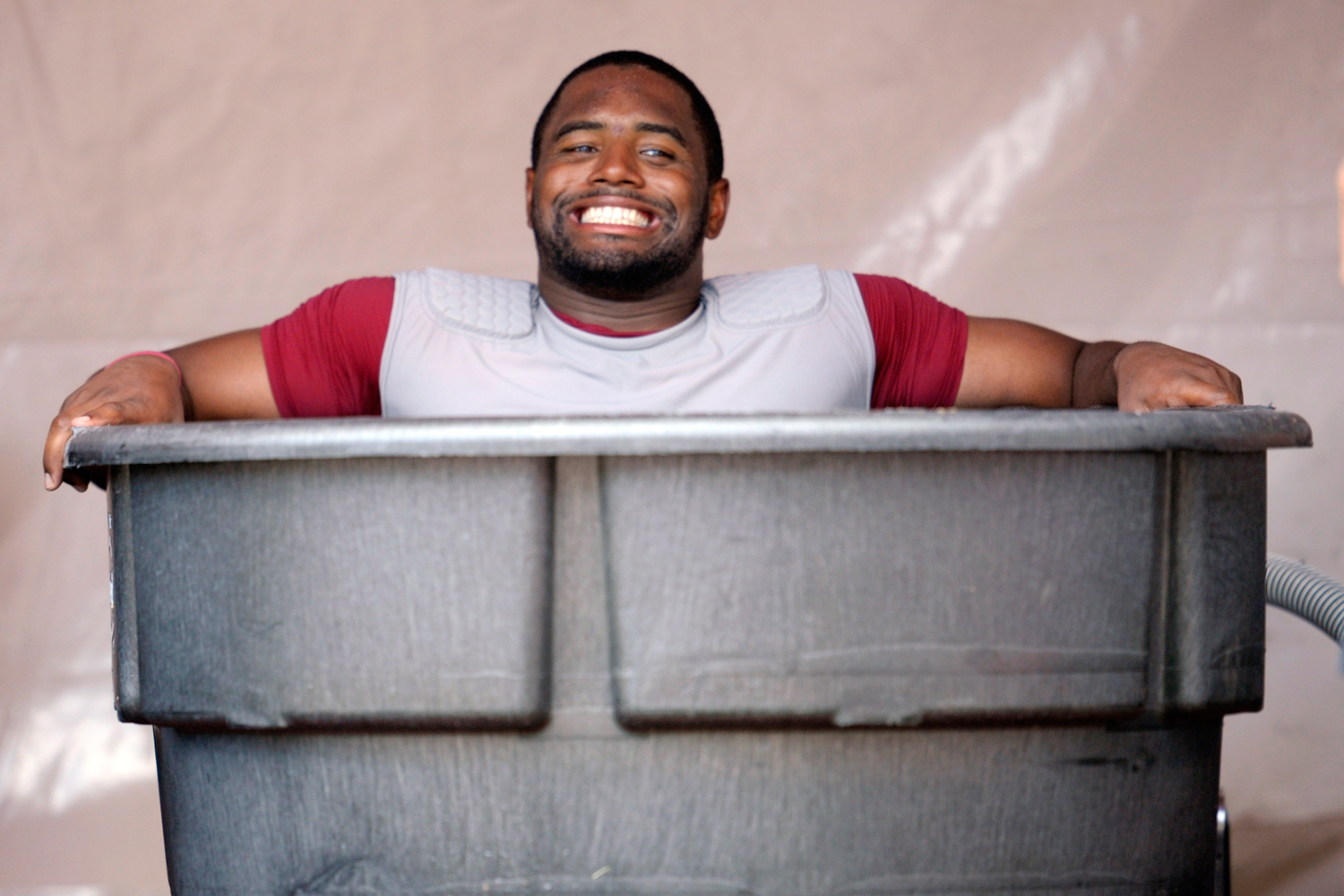 Washington Redskins fullback Darrel Young sighs as he sits in an ice bath after a day of training camp in July 2012.