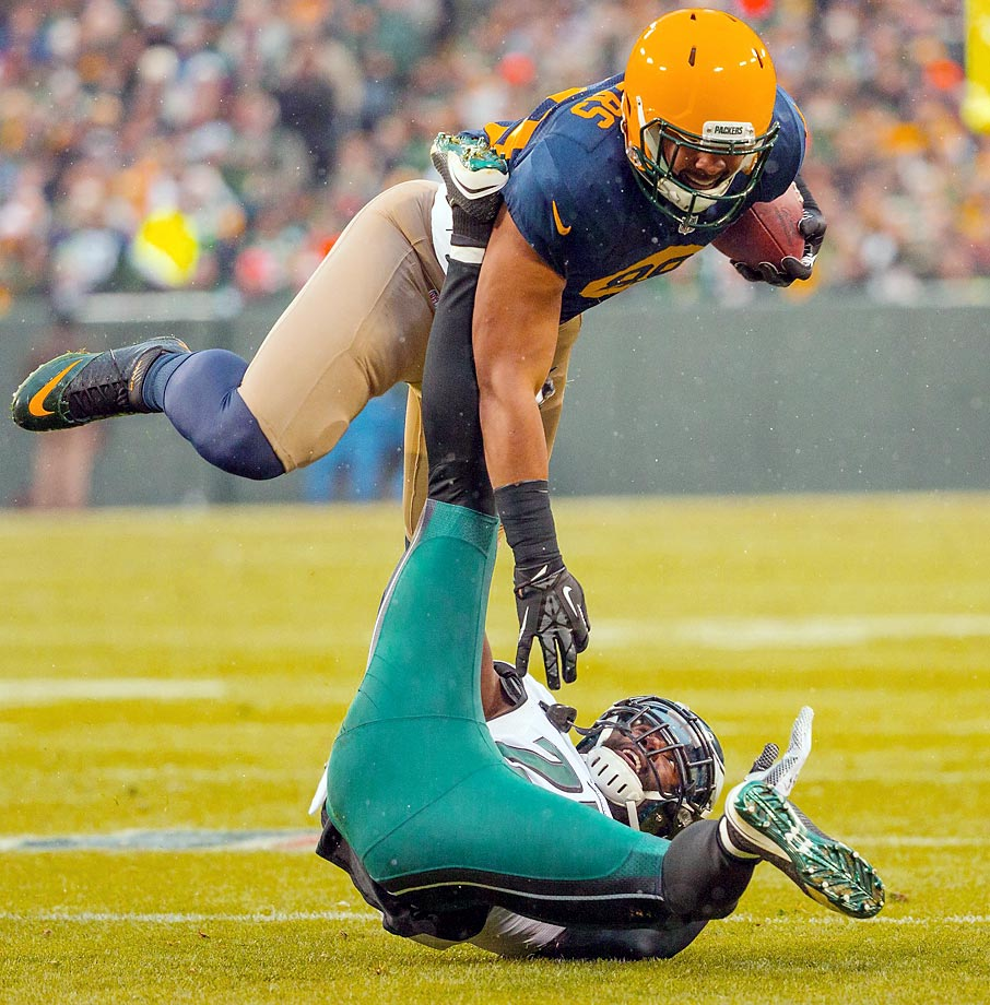 Green Bay's Richard Rogers hurdles Philadelphia Eagles defender Malcolm Jenkins.