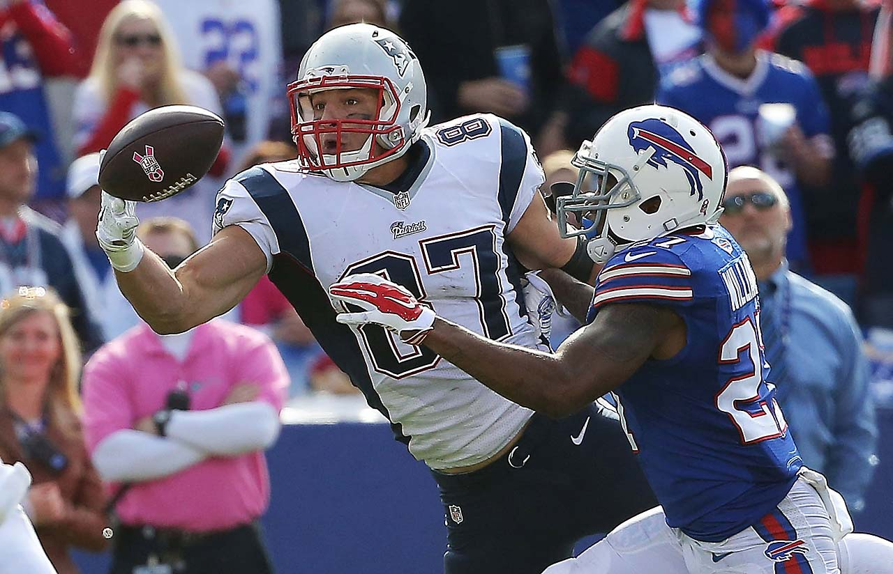 Rob Gronkowski of the New England Patriots makes a catch in front of  Duke Williams of the Buffalo Bills.