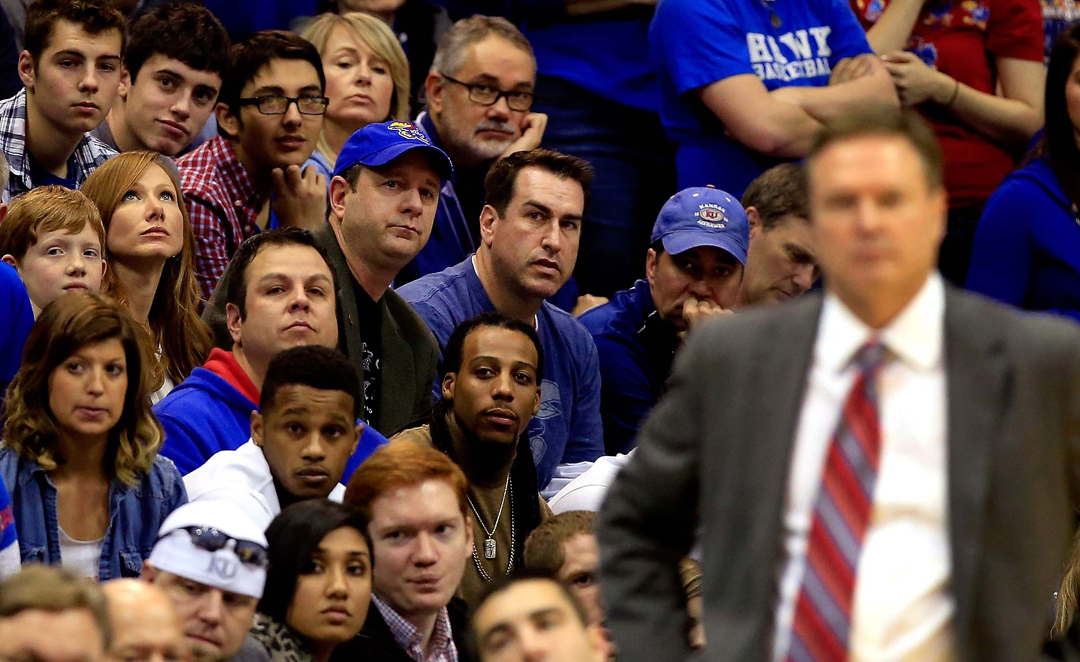Rob Riggle watches from behind head coach Bill Self and the Kansas bench during a 2014 game vs. Kansas State at Allen Fieldhouse in Lawrence, Kansas.
