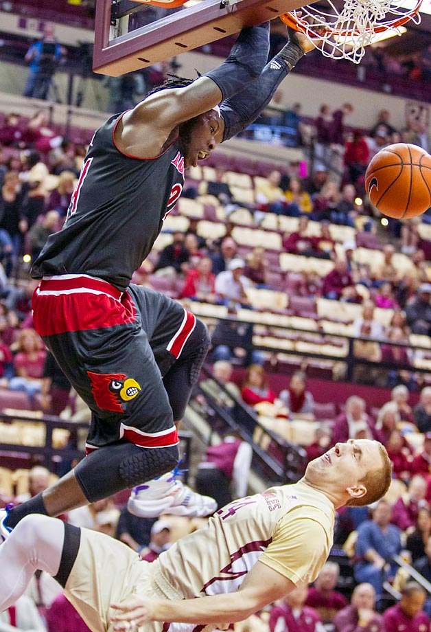 Florida State guard Robbie Berwick is called for a foul against Louisville forward Monterezl Harrell.