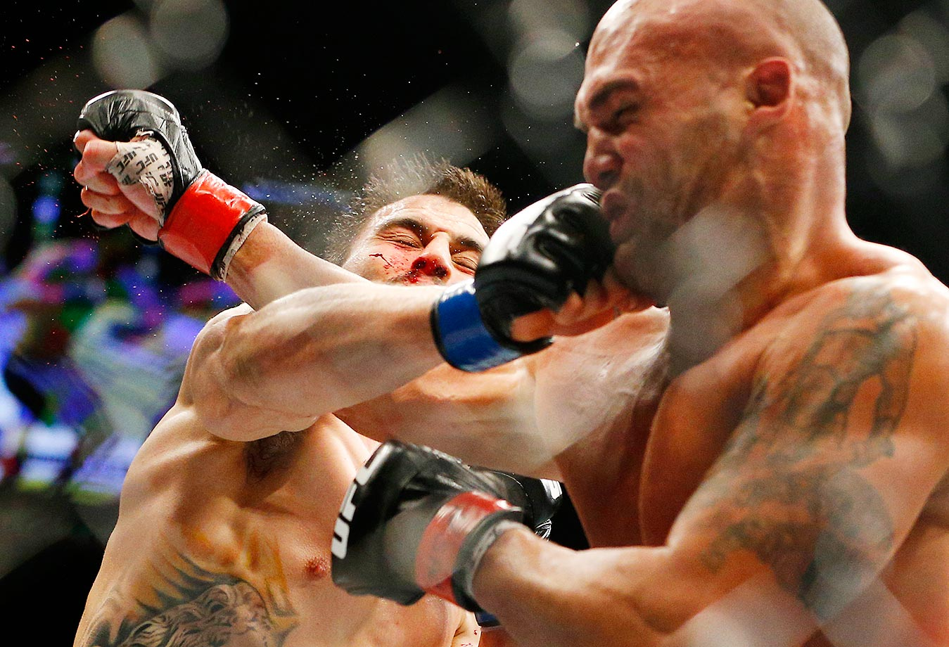 Robbie Lawler, right, trades blows with Carlos Condit during a welterweight championship MMA bout at UFC 195.