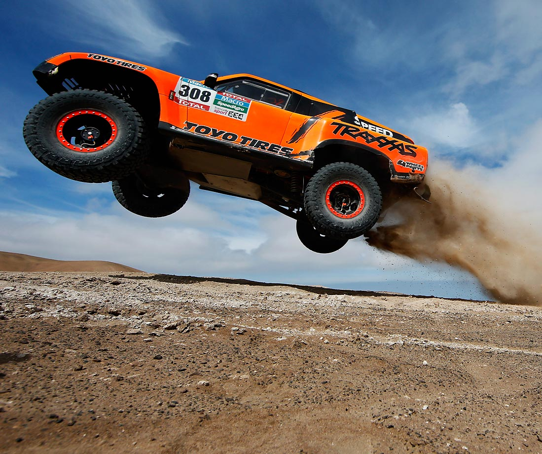 Robby Gordon and Johnny Campbell of the USA driving for Speed Energy Racing HST Hummer launches over a jump in the Atacama Desert during day 10 of the Dakar Rallly.