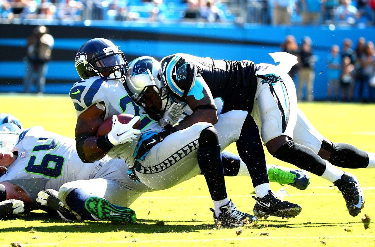 Robert Turbin gets nailed by a Carolina defender on a day when the Panthers held the Seahawks to 13 points, but still lost.