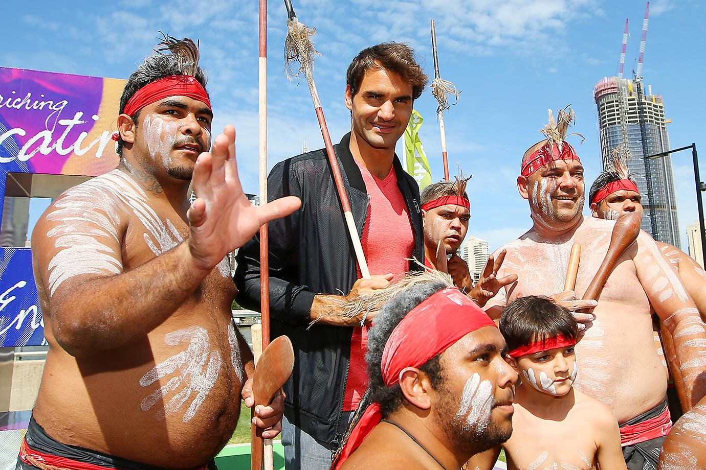 Roger Federer poses with representatives of the indigenous Mirrabooka tribe after a traditional Welcome to Country ceremony at South Bank ahead of the 2016 Brisbane International.